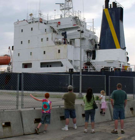Too close for comfort?  A family watches as a ship passes through the Massena locks (Photo:  Brian Mann)