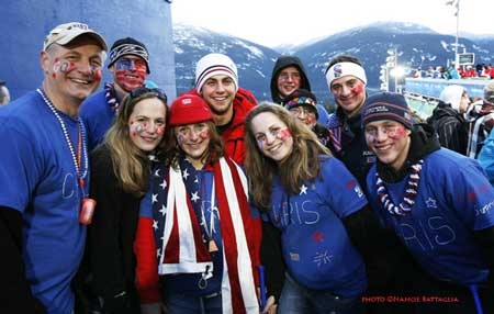 Luger Chris Mazdzer of Saranac Lake, in the red jacket, with hometown fans in Vancouver. he finished 13th in men's single competition yesterday. Photo by Nancie Battaglia.