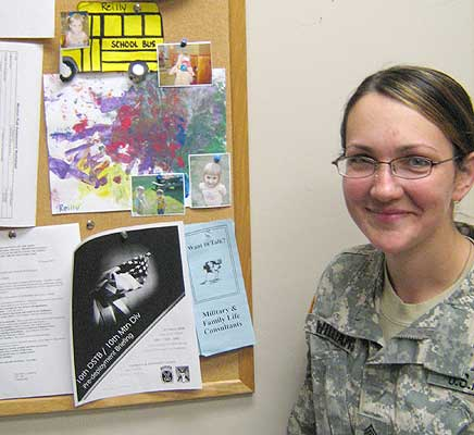 First Sergeant JR Williams with her daughter Reilly's artwork Photo: Brian Mann)