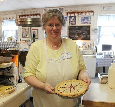 "Sharon Bastille (""Mom"") presents a pie. Photo: Nora Flaherty"