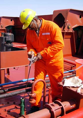The <i>Federal Kivalina</i>'s crew chief tests a ballast tank for invasive species