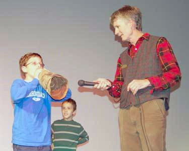 Cullen Rose of Inlet (left), his brother, Andy Quodomine of Clifton Park (center), and moose-calling contest emcee Ed Kanze (right). Photo: Andy Flynn