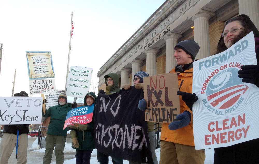 A small group braved single digit temperatures to express their opposition to the Keystone XL pipeline. A bill is currently under debate in Congress. Photo: David Sommerstein.