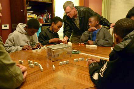 A game of dominos at HopePrint's house on the Northside of Syracuse. Photo: Ryan Delaney, WRVO