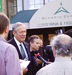 Gov. Pataki talks to the press outside the Olympic Arena. ORDA photo