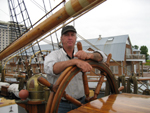 Capt. Dan Moreland at the helm of the <i>Picton Castle</i>.
