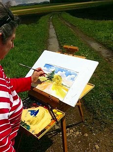 "Jackie Altman paints ""en plein air"" near Lake Placid."