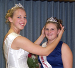 Departing princess Hannah Peck (L) crowns Alicia Jackson.