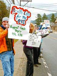 Dr. Chris Hyson, left, of Lake Placid, joins fellow activists. Photo courtesy of Adirondack Daily Enterprise.
