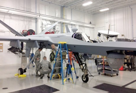 Trainees work on an MQ-9 Reaper at the Hancock field Air National Guard base near Syracuse, NY. Photo: David Sommerstein.