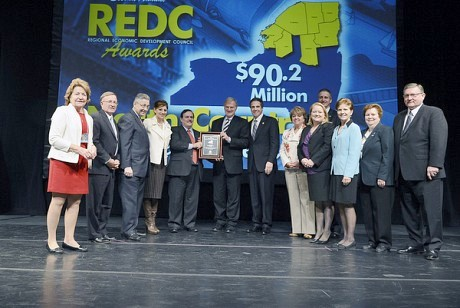 Politicians and economic development leaders join Governor Cuomo on stage Wednesday in Albany. (Photo: State of NY)