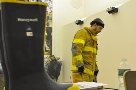 Tyler Hale, a firefighter in Cayuga Heights, tested leather and rubber boots to measure their effects on joint and muscle movement. Photo: Matt Richmond / WSKG