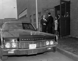Governor Rockefeller (facing camera) stands beside the Lincoln Continental Lehmann-Peterson limousine in 1967. Photograph courtesy of the New York State Archives.