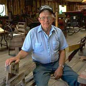 Auctioneer Roger Huntley in his museum of North Country rural life near his home outside Crary Mills.