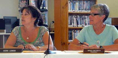 Saranac Lake school board President Debra Lennon, left, and Lake Placid school board President Mary Dietrich lead a discussion about sharing services between the two districts at a joint board meeting Wednesday in Saranac Lake. Photo: Adirondack Enterprise <br />