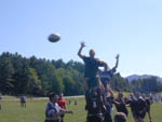 Reaching high for a rugby jumpball