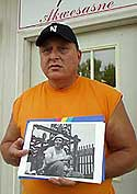 Akwesasne ironworker Bill Sears holds a photo of himself taken during the construction of the World Trade Center.
