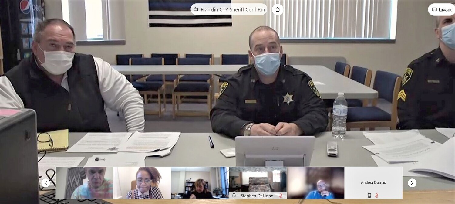 Deputies from the Franklin County Sheriff Department sat in front of a Blue Lives Matter flag at the police reform meeting in February.