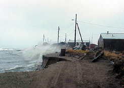 Increased erosion in Shishmaref is caused by sea level rise, more intense storms, and permafrost melting. Photo taken by the Shishmaref Relocation Coalition.