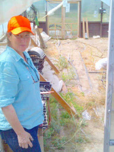 Lesley Trevor at Snowslip Farms shows her greenhouses, which still haven't been rebuilt. Photo: Nick Mann