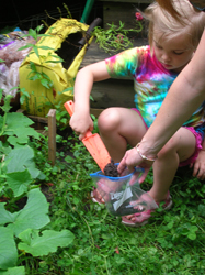 Reporter Karen Kelly and her daughter, Hannah, gather soil from their garden to be tested for toxins.