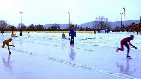 Competing on the speed skating oval in front of Lake Placid HS during the 1980 Winter Olympics. Source: Wikipedia Commons