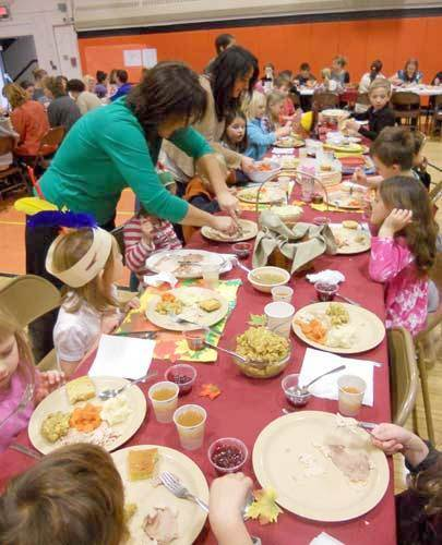 Long Lake kindergarteners and first graders fill their plates with turkey and the trimmings.  Photo: Todd Moe