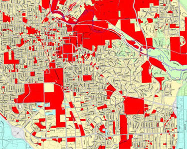 Tax-exempt parcels (shown in red) in a small city. Map: City of Ann Arbor, MI
