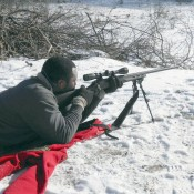 Darius Gibbs, a former soldier and member of the Watertown Sportsmen's Club, aims a rifle at the range. Photo: Joanna Richards