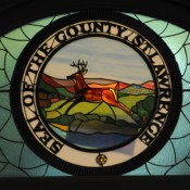 The seal of St. Lawrence County rendered in stained glass at the county building in Canton. Photo: Mark Kurtz