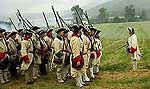 18th century French reenactors assemble during a recreated skirmish at Fort Ticonderoga