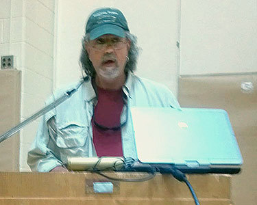 Tom Welsh, a fishing guide from Johnsburg, speaks at a public hearing on the new Finch Pruyn lands in Minerva. Photo: Nicholas Mann