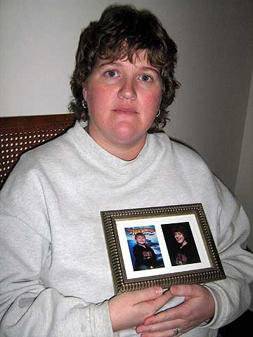 Tanya Towne holds a photograph of her two sons (Photo:  Brian Mann)
