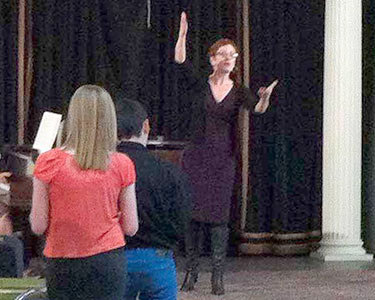 Broadway star Lisa Vroman leads singers from Jefferson and Lewis counties in a vocal workshop last month in Lowville.  Photo:  Todd Moe