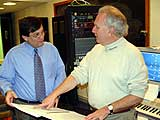 "Crane Chorus conductor Daniel Gordon (l) and composer Paul Steinberg (r) study the new score of ""Wind & Water""."