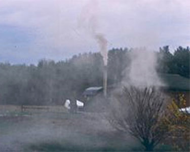 Smoke from an poorly controlled outdoor wood furnace. Photo: NYS DEC