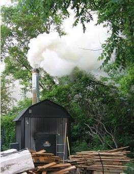 Outdoor wood furnace in operation. Source: Washington State Dept. of Ecology